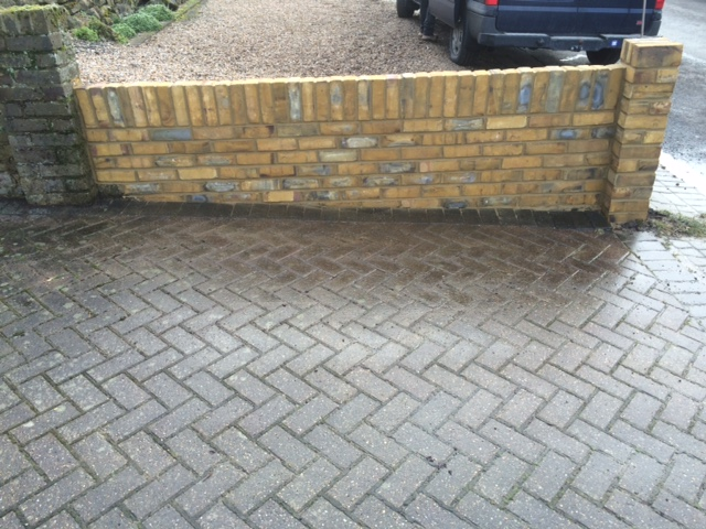 A driveway and wall completed by Nick