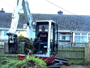Jon Mason posing in a digger